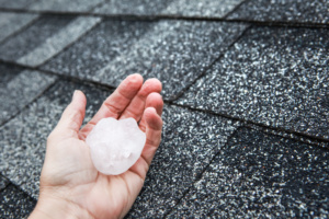 holding hail stone on roof